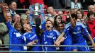 Chelsea players celebrate lifting the FA Cup after beating Liverpool