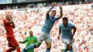 Carlos Tevez celebrates after capitalising on Martin Skrtel's error to equalise for City