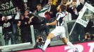 Andrea Pirlo celebrates after netting against Roma