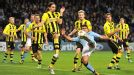 Neven Subotic moves to block Sergio Aguero's shot as Manchester City win a late penalty