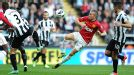 Manchester United goalscorer Tom Cleverley battles for the ball with Davide Santon