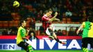 Milan's Philippe Mexes acrobatically clears his lines against Chievo