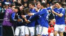 Jefferson Farfan is mobbed after scoring the goal which earned Schalke a 2-2 draw with Arsenal