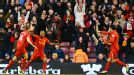Liverpool celebrate after Luis Suarez scored thir opening goal against Wigan