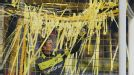 Dortmund goalkeeper Roman Weidenfeller removes paper streamers from his goal during the game against Wolfsburg