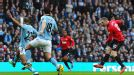 Wayne Rooney scores for Man United against Man City