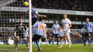 Coventry's Carl Baker tries in vain to prevent Clint Dempsey's header putting Tottenham 3-0 up