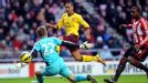 Theo Walcott is denied by the post as he looks to increase Arsenal's advantage
