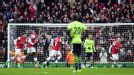 Santi Cazorla wheels away following his goal against Aston Villa