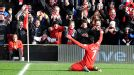 Luis Suarez celebrates after his first time finish have Liverpool the lead at home to Spurs 