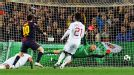 Milan goalkeeper Christian Abbiati is powerless to stop Lionel Messi from scoring his second