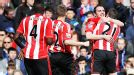 Sunderland celebrate after C�sar Azpilicueta put John O'Shea's header into his own net