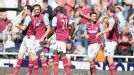 West Ham players celebrate their opening goal against Wigan