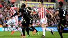 Charlie Adam fires Stoke into the lead against Norwich