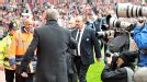 Sir Alex Ferguson moves to shake hands with Rafa Benitez