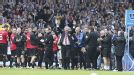 Sir Alex Ferguson takes the applause of the West Brom crowd before his 1,500th and final game