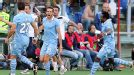 Lazio celebrate after Senad Lulic (c) scored the winner against arch rivals Roma in the Coppa Italia
