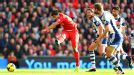 Luis Suarez fires home his first against West Brom.