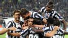 Arturo Vidal is mobbed, and crushed, after putting Juventus in front from the spot.