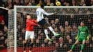Emmanuel Adebayor heads Spurs into the lead at Man United.