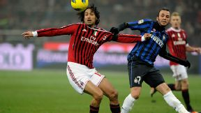 Alessandro Nesta does battle with Giampaolo Pazzini