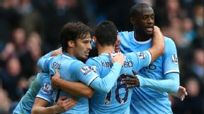 Man City players celebrate during their Premier League game against Arsenal.