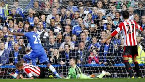 Samuel Eto'o turns to celebrate after giving Chelsea the lead against Sunderland.