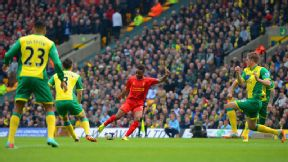 Raheem Sterling fires home to give Liverpool the early lead against Norwich.