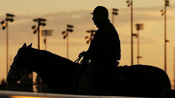 Trainer D. Wayne Lukas watches morning workouts at Churchill Downs.