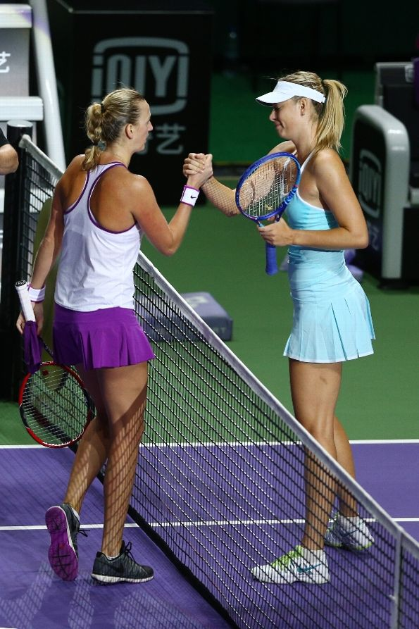 SINGAPORE - OCTOBER 31: Petra Kvitova of Czech Republic shakes hands with Maria  Sharapova of Russia after defeating her in the semi-final match of the BNP  ...