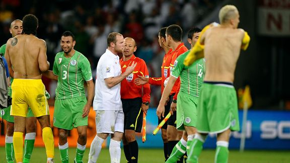 Wayne Rooney speaks to referee Ravshan Irmatov at the end of the game