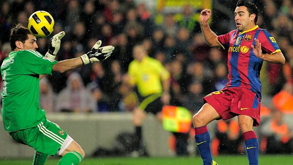 Xavi taps the ball past Iker Casillas for Barca's first goal