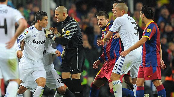Cristiano Ronaldo and Victor Valdes were both booked for a coming together