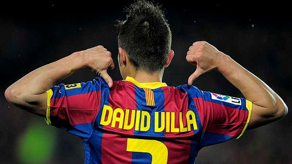 David Villa accepts the plaudits after his double