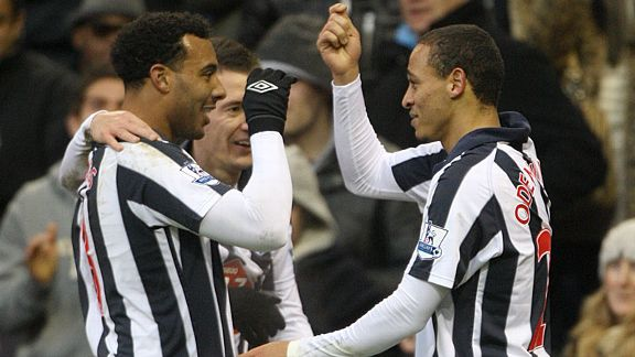 Peter Odemwingie celebrates his second goal with Giles Barnes