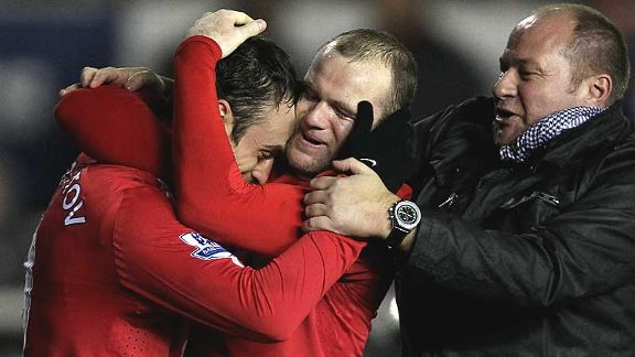 Berbatov is congratulated by Wayne Rooney and AN Other.