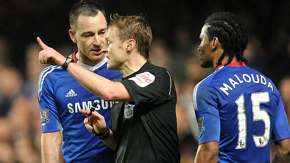 Chelsea's John Terry and Florent Malouda remonstrate with referee Mike Jones