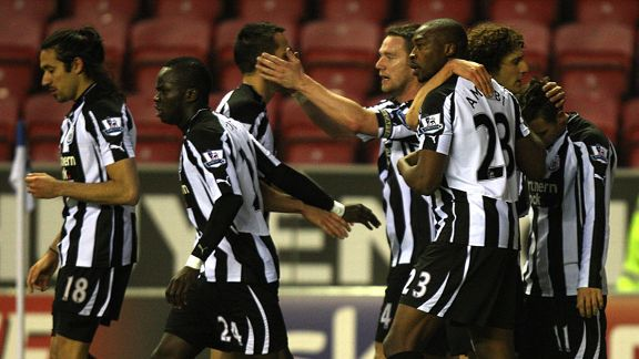 Newcastle celebrate after Shola Ameobi's opening goal against Wigan