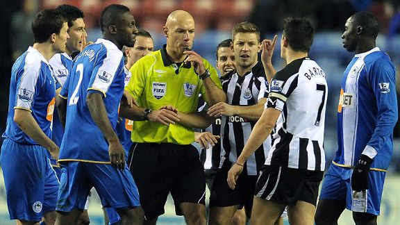Joey Barton pleads with referee Howard Webb for leniency