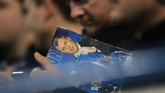 A supporter reads about Paul Jewell's arrival at Ipswich Town