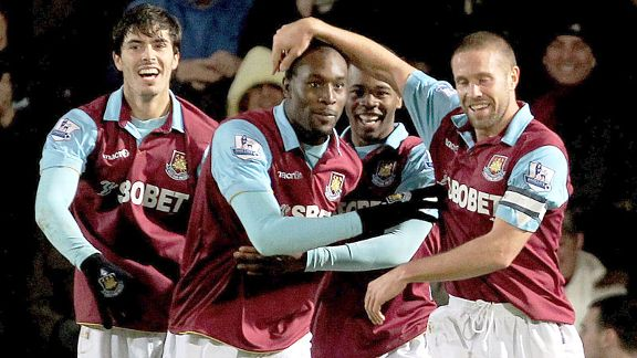 Carlton Cole is mobbed after bagging the winner against Birmingham City