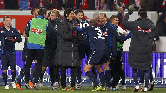 Freiburg celebrate their winner against Stuttgart