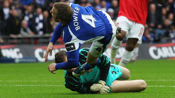 Lee Bowyer is brought down by Wojciech Szczesny