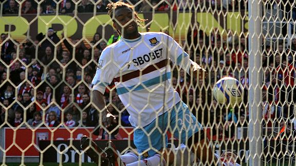 West Ham United's Frederic Piquionne bundles the ball over the line to score his team's opening goal.