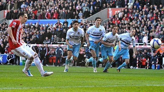 Matthew Etherington takes a penalty, which is then saved by West Ham United's goalkeeper Robert Green