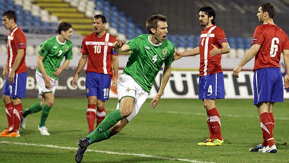 Gareth McAuley celebrates his goal for Northern Ireland.