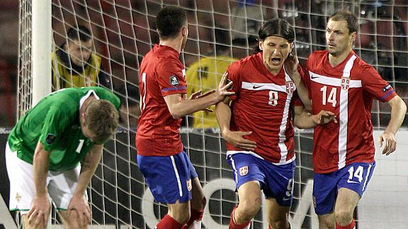 Serbia celebrate after Marko Pantelic (8) levelled.
