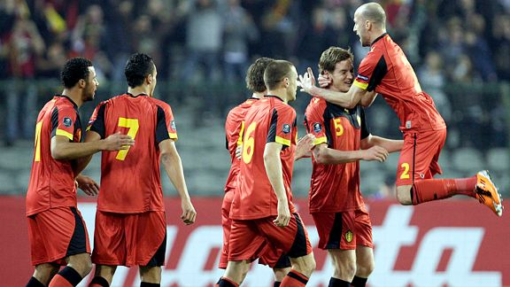 Jan Vertonghen is mobbed after he put Belgium into a 12th minute lead, and they went on to beat Azerbaijan 4-1.