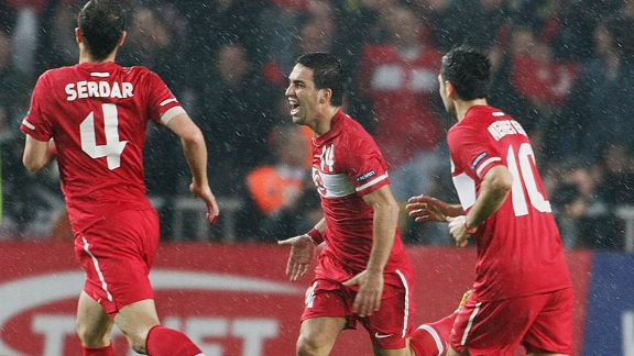 Turkey celebrate after Arda Turan (c) put them in front at home to Austria