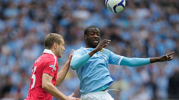 Nemanja Vidic and Yaya Toure